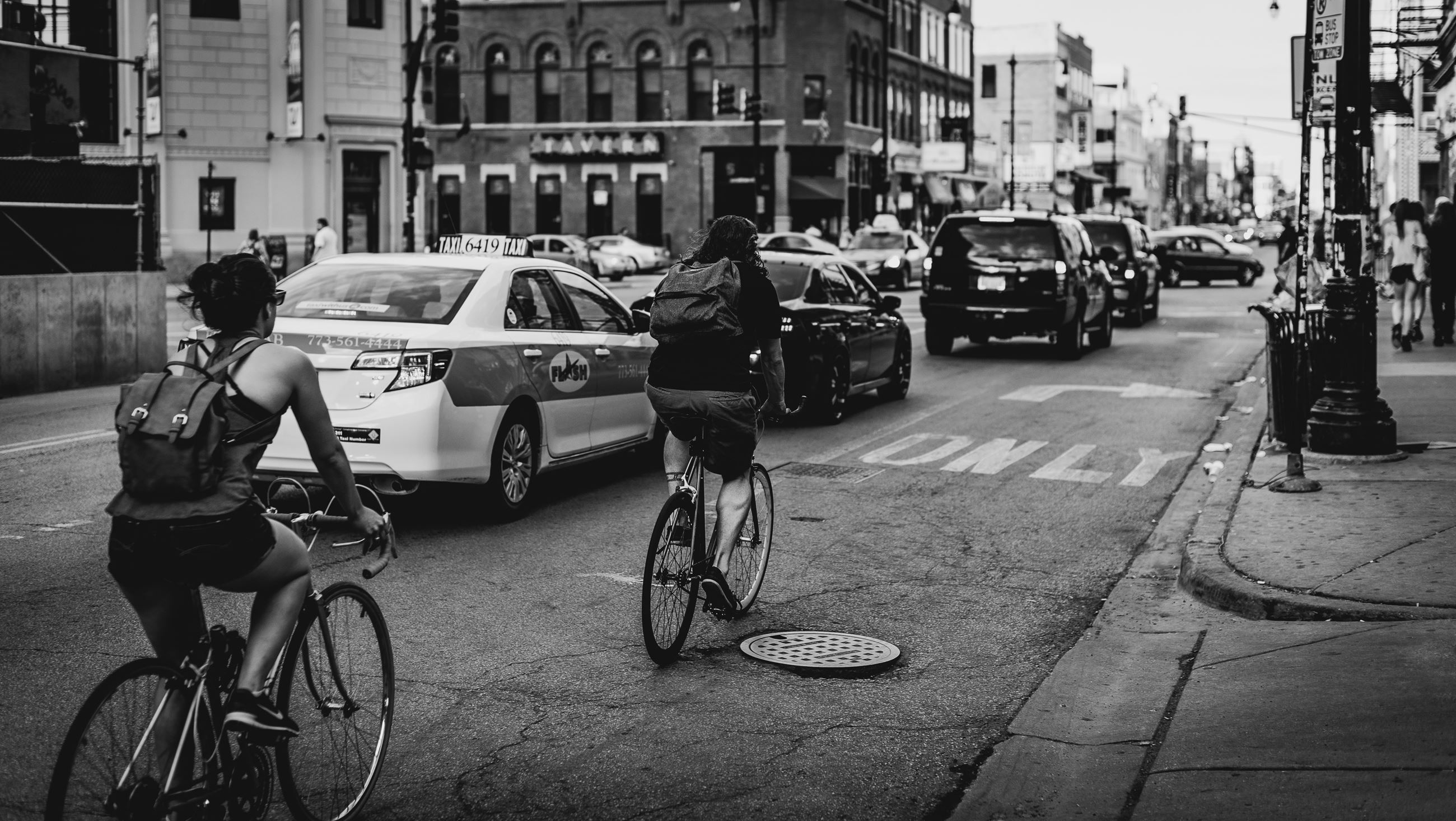 1.5_bike_cars_Photo by Adrian Williams on Unsplash