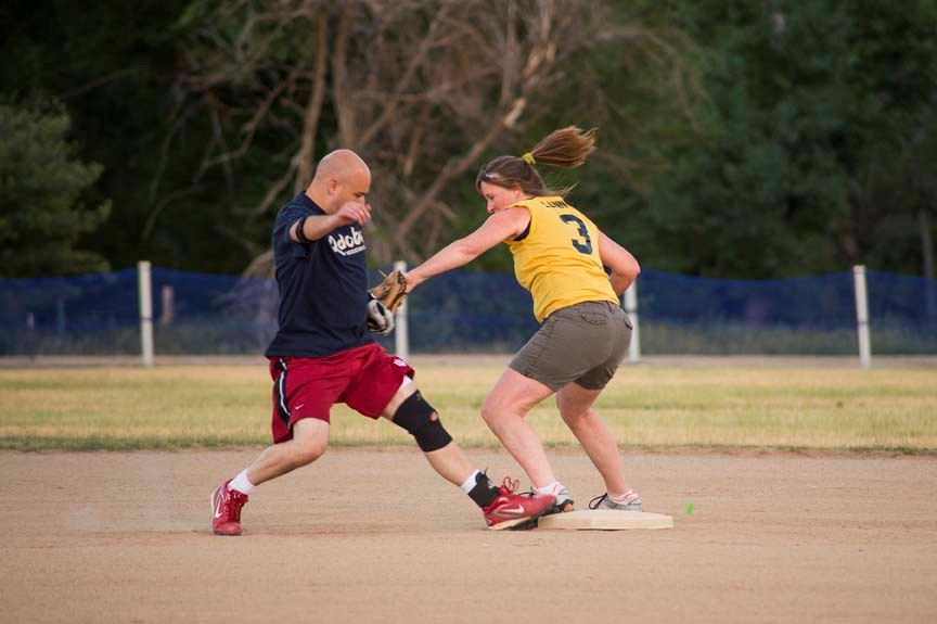 Coed Softball tagging runner at second base